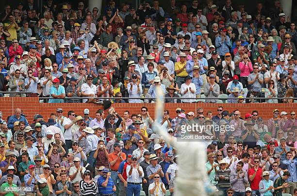The crowd applauds as Michael Clarke of Australia reaches his century during day two of the Second Ashes Test Match between Australia and England at...