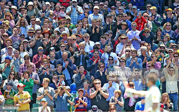 The crowd applauds as Steven Smith of Australia reaches his century during day two of the Second Test match between Australia and the West Indies at...