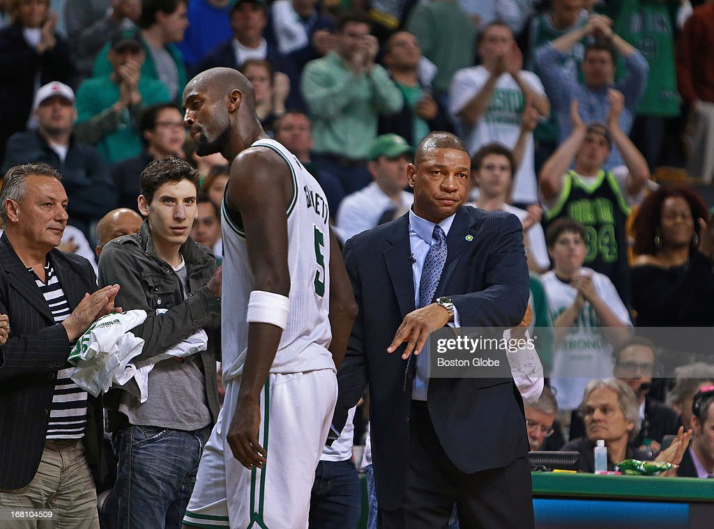 The crowd applauds as the Celtics Kevin Garnett leaves the game as the clock winds down. He has just come out of an embrace with head coach Doc Rivers, right. The Boston Celtics hosted the New York Knicks for Game Six of the NBA Eastern Conference Quarterfinals at the TD Garden.