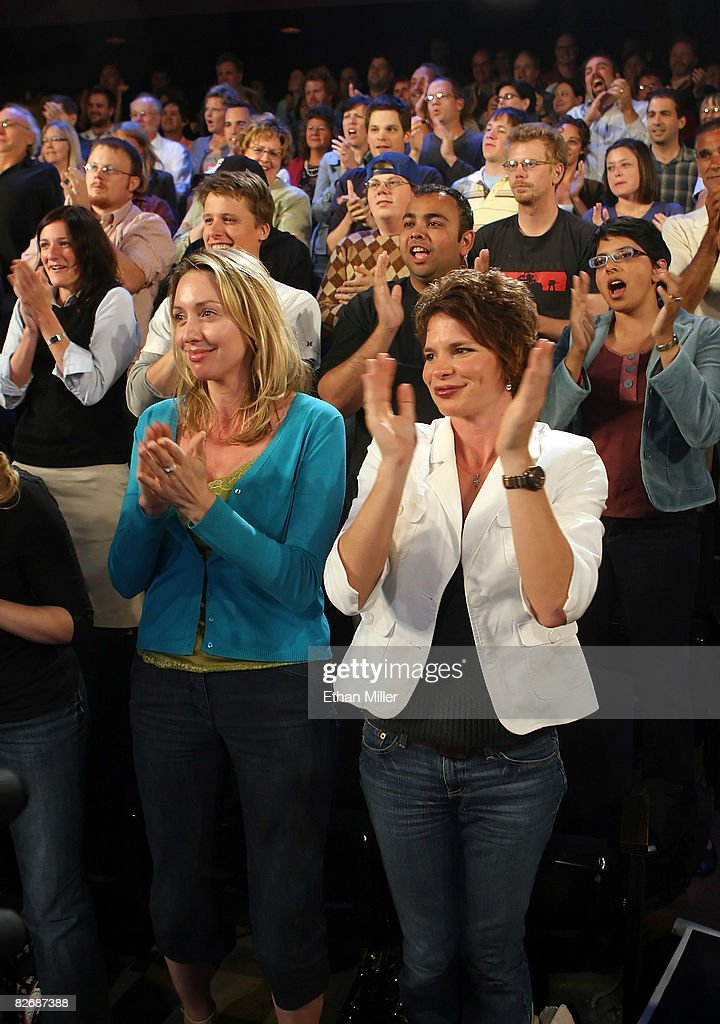 The crowd applauds as they attend a taping of 'The Daily Show with <a gi-track='captionPersonalityLinkClicked' href=/galleries/search?phrase=Jon+Stewart+-+Political+Satirist&family=editorial&specificpeople=202151 ng-click='$event.stopPropagation()'>Jon Stewart</a>: Restoring Honor & Dignity to the White House' at the McNally Smith College of Music September 5, 2008 in St. Paul, Minnesota. The show is being taped in St. Paul during the week of the Republican National Convention.