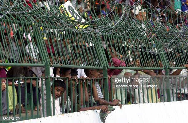 The crowd are fenced in with barbed wire during the One Day International at the Premadasa Stadium Colombo Sri Lanka