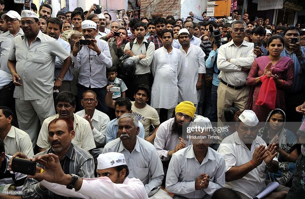 The crowd assembled during a protest against inflated electricity and water bills at Sundar Nagari on March 29, 2013 in New Delhi, India. Arvind Kejriwal, said the prices of power and water in Delhi had gone up many times because of corruption of Sheila Dikshit Government. Responding to the allegation made by Delhi Chief Minister that people can't use 24 hours power supply and pay only for 8 hours, Arvind Kejriwal challenged Shiela Dikshit for an open debate anywhere anytime in front of the people of Delhi.