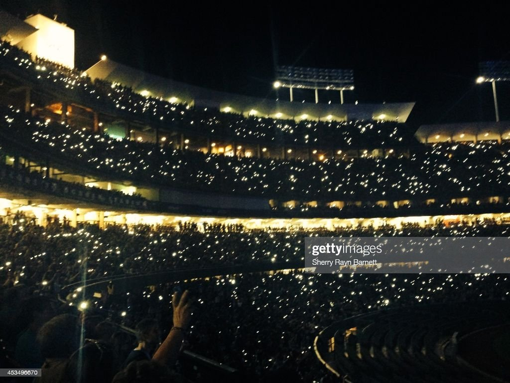 The crowd at Dodger Stadium enjoy a concert by Paul McCartney on August 10, 2014 in Los Angeles, California.