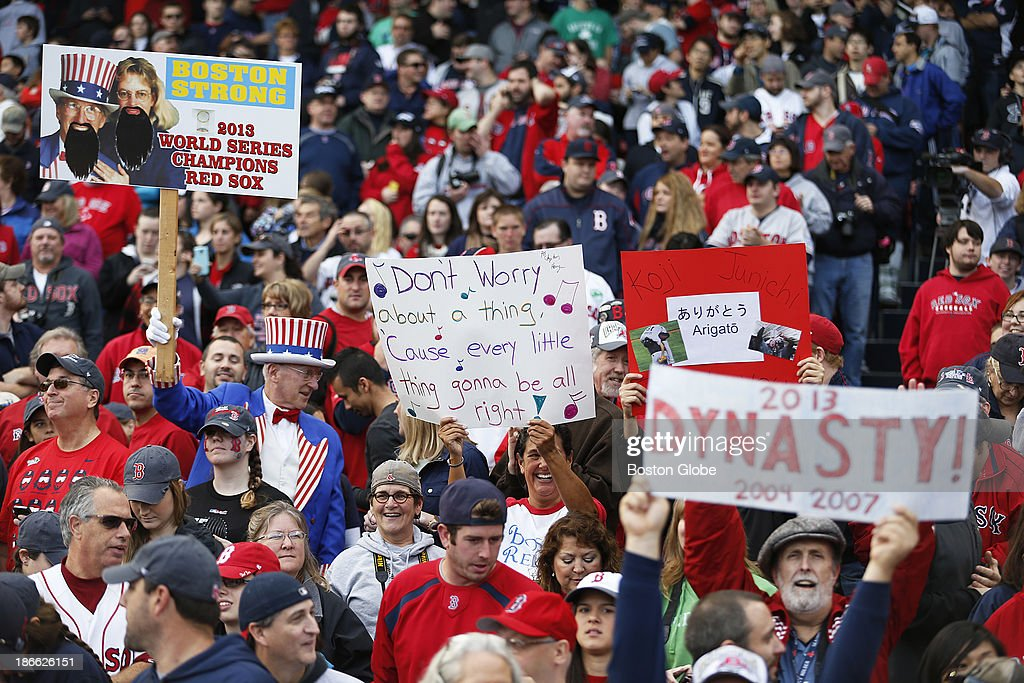 The crowd at Fenway Park held various signs. The Red Sox Rolling Rally started at Fenway Park and paraded around Boston after the Boston Red Sox won the 2013 World Series, on Saturday, Nov. 2, 2013.