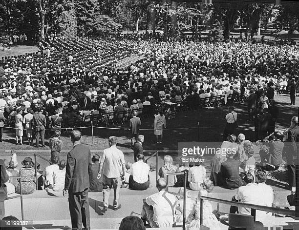 AUG 23 1964 The crowd at University of Colorado summer graduation Saturday listen while Joseph R Smiley president says the ceremony has special...