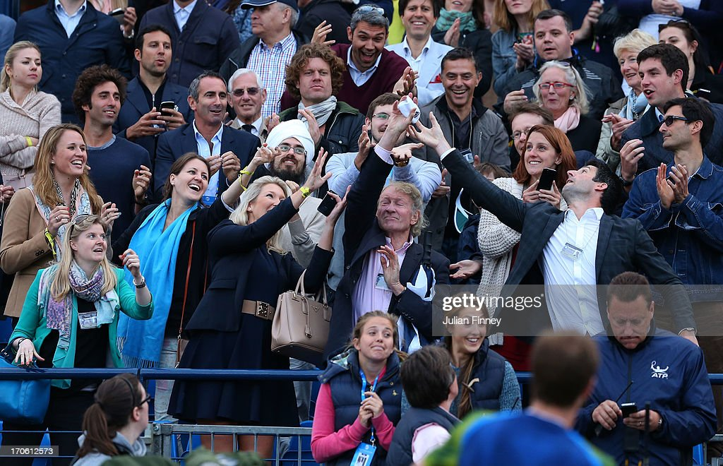The crowd catch the wristbands of Andy Murray of Great Britain after his victory during the Men's Singles semi final round match against Jo-Wilfried Tsonga of France on day six of the AEGON Championships at Queens Club on June 15, 2013 in London, England.
