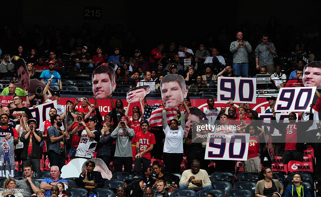 The crowd celebrates Kyle Korver #26 of the Atlanta Hawks record breaking night against the Cleveland Cavaliers on December 6, 2013 at Philips Arena in Atlanta, Georgia.
