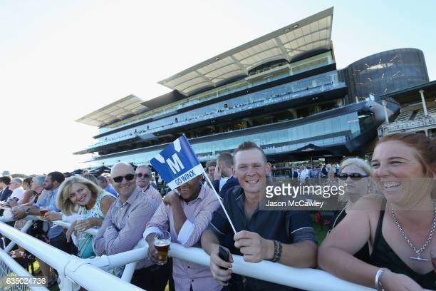 The crowd cheer on Winx during the Apollo Stakes at Royal Randwick Racecourse on February 13 2017 in Sydney Australia