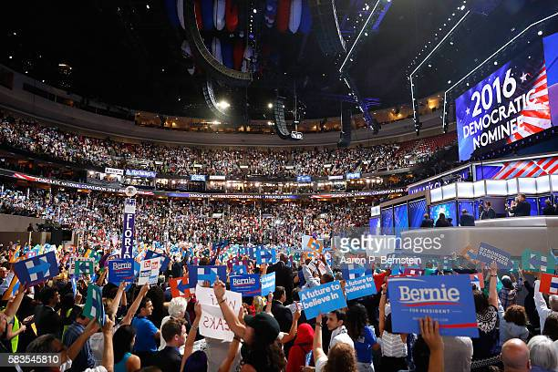 The crowd cheers after formally nominating Democratic presidential candidate Hillary Clinton on the second day of the Democratic National Convention...