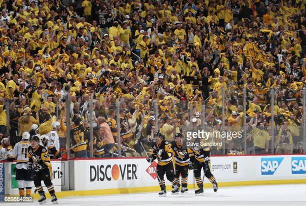 The crowd cheers after Jake Guentzel of the Pittsburgh Penguins scored the gamewinning goal against the Nashville Predators during the third period...