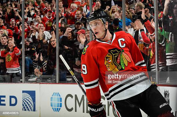 The crowd cheers as Jonathan Toews of the Chicago Blackhawks skates around the boards after scoring against the Colorado Avalanche in the first...