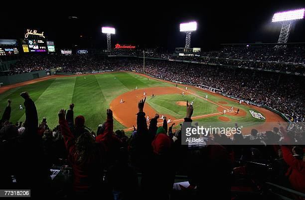 The crowd cheers as Mike Lowell of the Boston Red Sox hits a two RBI single in the third inning during Game Two of the American League Championship...