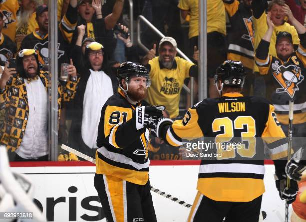 The crowd cheers as Phil Kessel of the Pittsburgh Penguins celebrates his goal with teammate Scott Wilson during the second period of Game Five of...