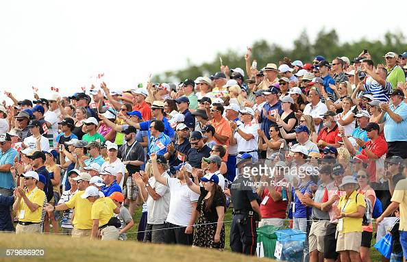 The crowd cheers for Jared du Toit of Canada as he walks up the 18th fairway during the final round of the RBC Canadian Open at Glen Abbey Golf Club...