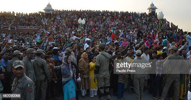 The crowd during a daily parade at the PakistanIndia joint checkpost at Wagah border India and Pakistan solemnly lowered their national flags at a...