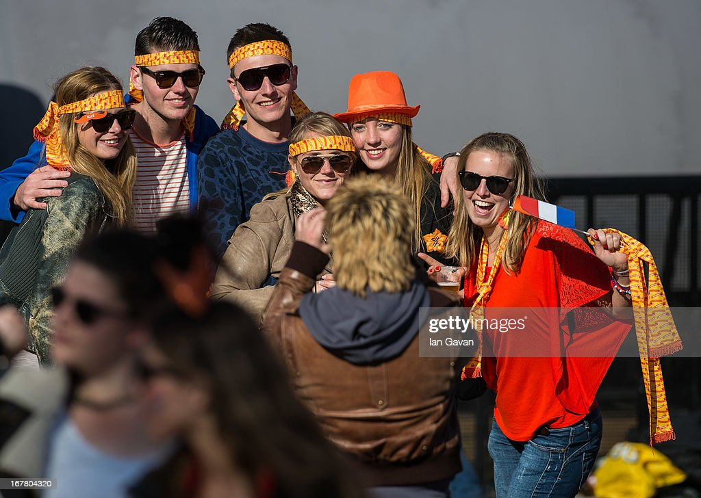The crowd enjoy the atmosphere at Museumplien during the inauguration of King Willem Alexander of the Netherlands as Queen Beatrix of the Netherlands abdicates on April 30, 2013 in Amsterdam, Netherlands.