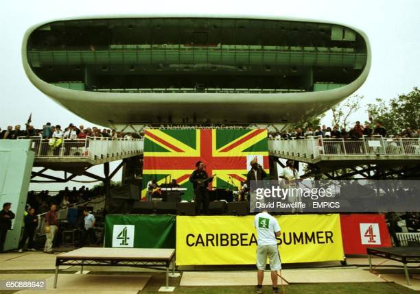 The crowd enjoy the music at the first of Channel 4's Caribbean Summer concerts as 'Third World' play in front of the Media Centre at Lord's during...