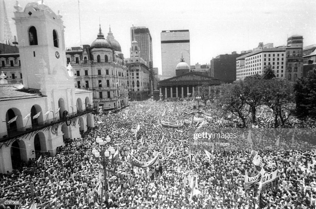 The crowd fills the Plaza de Mayo 10 December 1983 in Buenos Aires during the inauguration of President Raul Alfonsin Argentina will celebrate on...