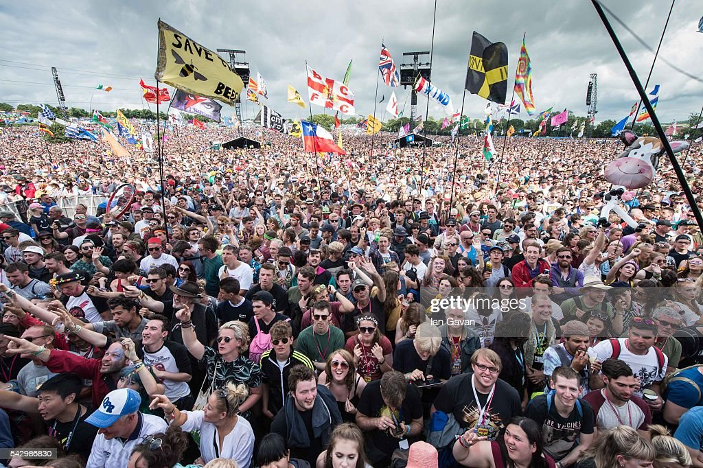 the crowd gather at the Pyramid Stage on day 2 of the Glastonbury Festival at Worthy Farm, Pilton on June 25, 2016 in Glastonbury, England. Now in its 46th year the festival is one largest music festivals in the world and this year features headline acts Muse, Adele and Coldplay. The Festival, which Michael Eavis started in 1970 when several hundred hippies paid just £1, now attracts more than 175,000 people.