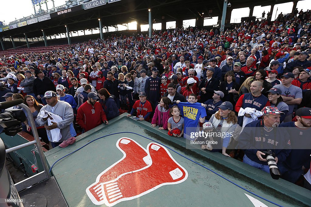 The crowd gathered at Fenway Park, the Red Sox bullpen top seen in the foreground. The Red Sox Rolling Rally started at Fenway Park and paraded around Boston after the Boston Red Sox won the 2013 World Series, on Saturday, Nov. 2, 2013.
