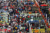 The crowd gathered in the grid stand for the national anthem during the NASCAR Sprint Cup Series Sylvania 300 at New Hampshire Motor Speedway on...