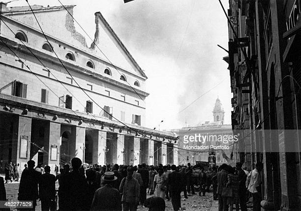 The crowd gathering in front of Teatro Carlo Felice in Genoa damaged by the bombing of August 1943 Genoa 1943