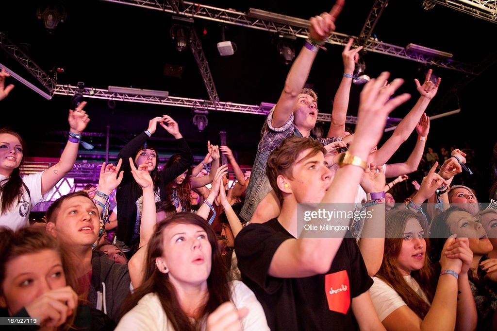 The crowd in the front row watch on as Don Broco perform on stage at Rock City headlining the Hit The Deck Festival 2013 at Rock City on April 21, 2013 in Nottingham, England.