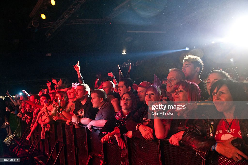 The crowd in the front row watch on as Rancid perform during the first English night of the 20th anniversary tour onstage at Rock City on December 1, 2012 in Nottingham, England.