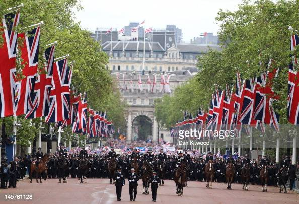 The crowd is escorted down The Mall during the Diamond Jubilee carriage procession after the service of thanksgiving at StPaul's Cathedral on the...
