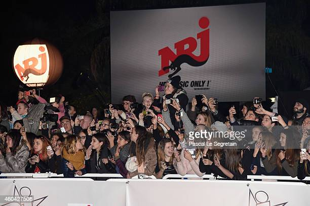 The crowd is seen during the NRJ Music Awards arrivals at Palais des Festivals on December 13 2014 in Cannes France