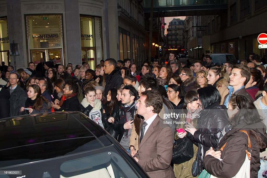 The crowd is waiting to see Selena Gomez, Ashley Benson and Vanessa Hudgens at the 'Printemps' department store on February 16, 2013 in Paris, France.