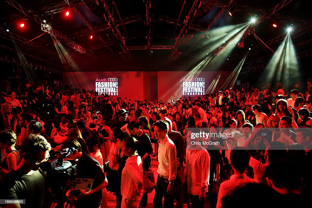 The crowd leaves after watching the Audi Star Creation Capsule Showcase on May 17, 2013 in Singapore.