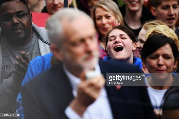 The crowd listen to leader of the Labour Party Jeremy Corbyn as he delivers a speech at a campaign rally in Beaumont Park after launching the Labour...