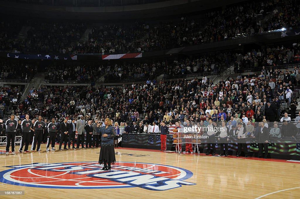 The Crowd listens to the National Anthem prior to the Detroit Pistons and the Miami Heat on December 28, 2012 at The Palace of Auburn Hills in Auburn Hills, Michigan.