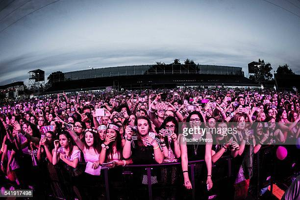 The crowd of the girl pop band Little Mix pictured on stage as they perform live at Street Music Art in Assago Milan Italy