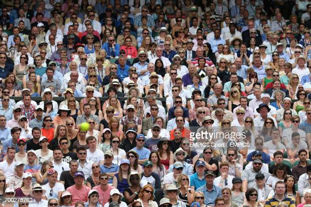 The crowd on Centre Court watch Belgium's David Goffin in action against Great Britain's Andy Murray