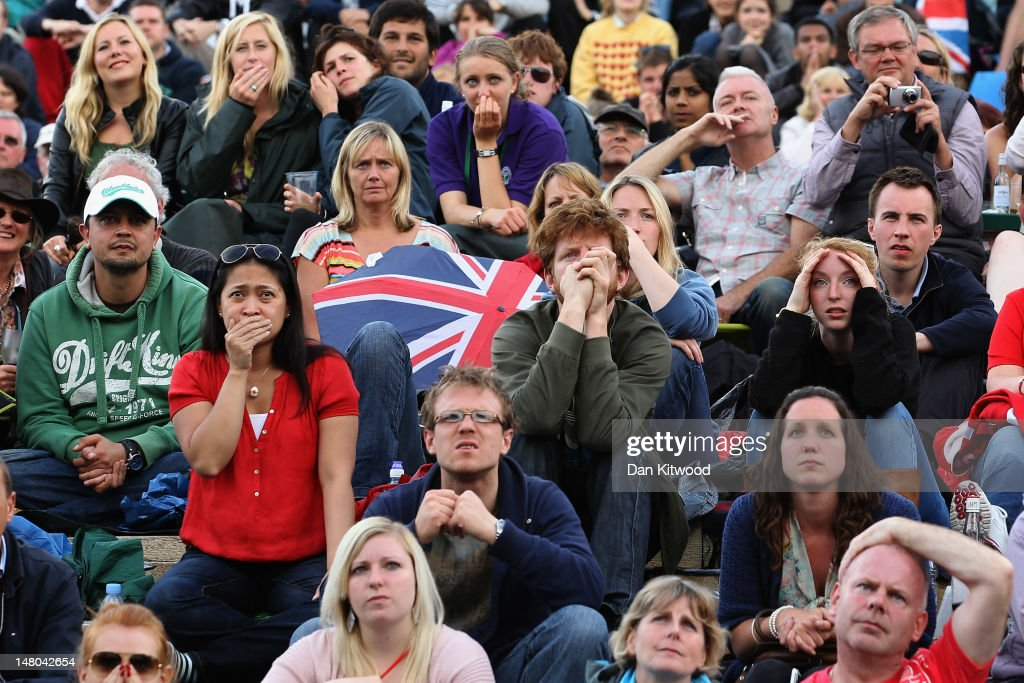 The crowd on Murray Mount react as Andy Murray loses his Gentlemen's Singles final match against Roger Federer on day thirteen of the Wimbledon Lawn Tennis Championships at the All England Lawn Tennis and Croquet Club on July 8, 2012 in London, England.