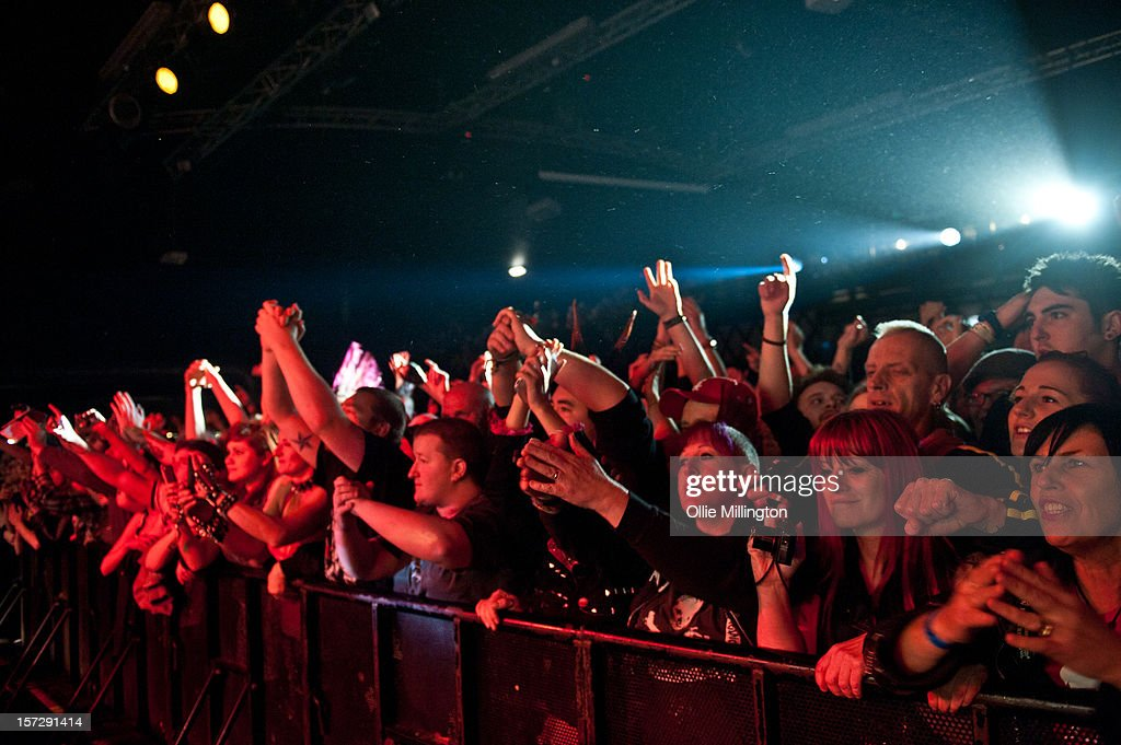 The crowd on the front row watch on as Rancid perform during the first English night of the 20th anniversary tour onstage at Rock City on December 1, 2012 in Nottingham, England.