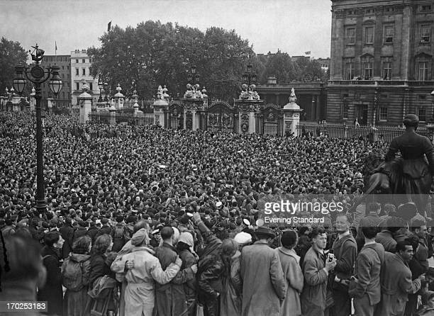 The crowd outside Buckingham Palace cheer for the Royal Family after the Coronation London 2nd June 1953