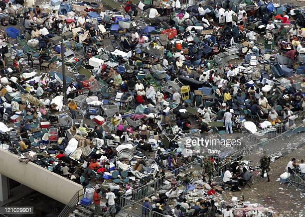 The crowd outside the Superdome in New Orleans on Saturday September 3 2005 The city remains under water as military helicopters evacuate people