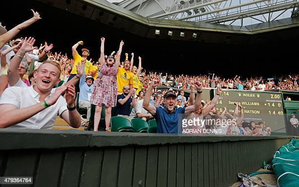 The crowd react as Britain's Heather Watson wins the fifth game in the third set during her women's singles third round match against US player...