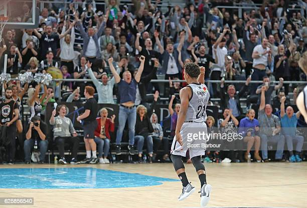 The crowd reacts and Casper Ware of Melbourne United celebrates after hitting the winning three point basket in the final second during the round...