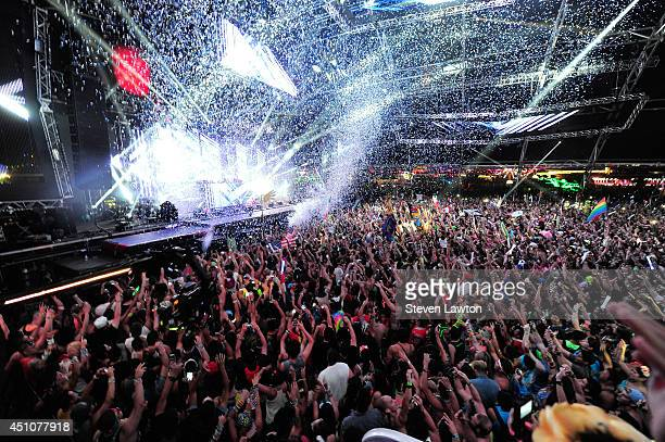The crowd reacts as Calvin Harris performs at the 18th annual Electric Daisy Carnival at Las Vegas Motor Speedway on June 22 2014 in Las Vegas Nevada