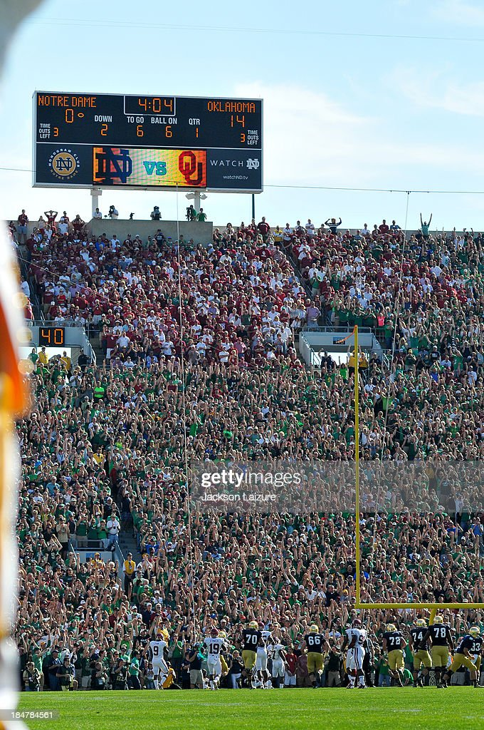 The crowd reacts to quarterback <a gi-track='captionPersonalityLinkClicked' href=/galleries/search?phrase=Tommy+Rees+-+American+Football+Player&family=editorial&specificpeople=7175395 ng-click='$event.stopPropagation()'>Tommy Rees</a> #11 throwing a touchdown pass to wide receiver T.J. Jones #6 of the Notre Dame Fighting Irish during their loss to the Oklahoma Sooners on September 28, 2013 at Notre Dame Stadium in South Bend, Indiana.