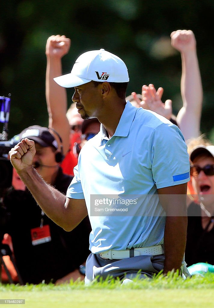 The crowd reacts with <a gi-track='captionPersonalityLinkClicked' href=/galleries/search?phrase=Tiger+Woods&family=editorial&specificpeople=157537 ng-click='$event.stopPropagation()'>Tiger Woods</a> after chipping in for birdie on the 13th green during the Third Round of the World Golf Championships-Bridgestone Invitational at Firestone Country Club South Course on August 3, 2013 in Akron, Ohio.