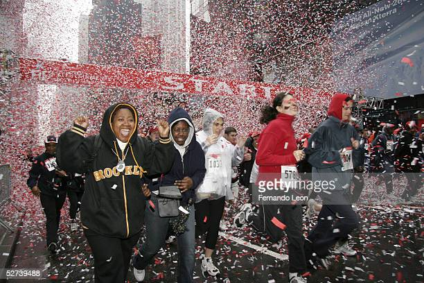 The crowd runs during the 8th Annual Revlon Run/Walk for Women at Times Square April 30 2005 in New York City