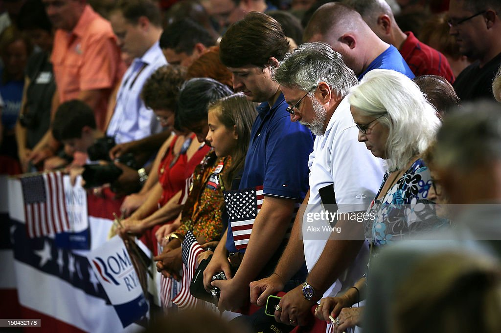 The crowd say a prayer at the beginning of a campaign rally of Republican U.S. Vice Presidential candidate Rep. Paul Ryan (R-WI) at West Springfield High School August 17, 2012 in Springfield, Virginia. Rep. Ryan continued to campaign for the upcoming general elections.