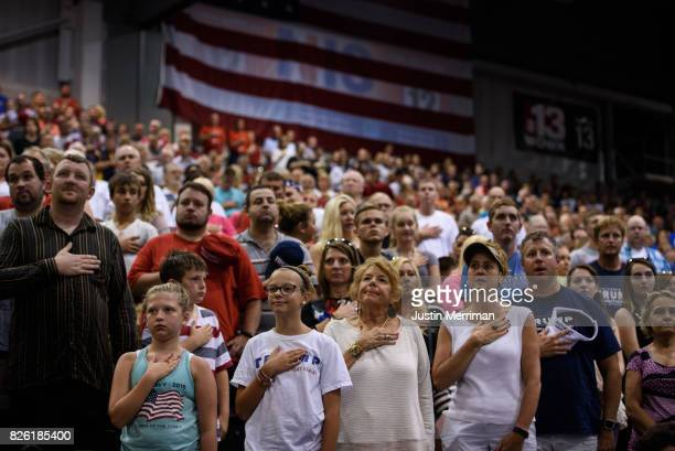 The crowd stands during the Pledge of Allegiance during President Donald J Trump's campaign rally at the Big Sandy Superstore Arena on August 3 2017...
