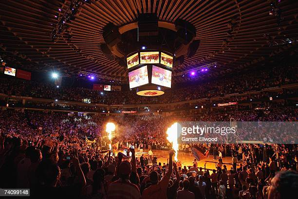 The crowd stands for player introductions before the Dallas Mavericks game against the Golden State Warriors in Game Four of the Western Conference...