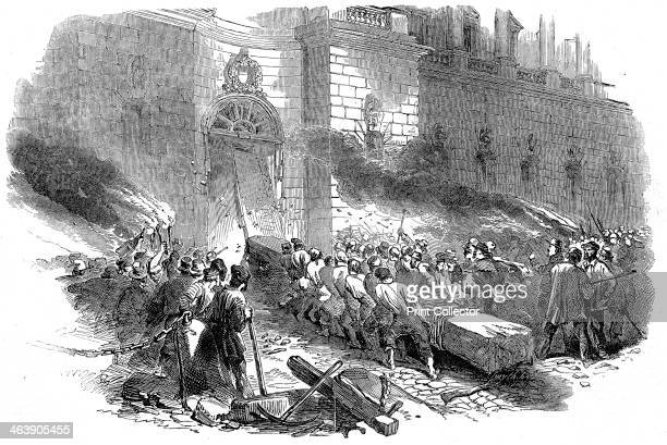 The crowd storming the Arsenal in Berlin Revolution in Prussia March 1848 Wood engraving 1848